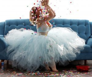 Megan Love wearing blue tutu and throwing confetti