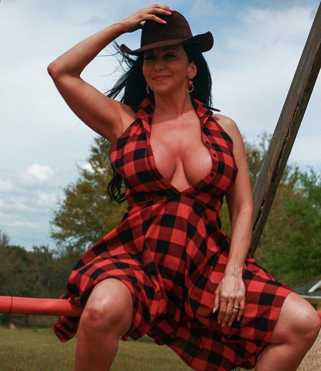 Brenda Boobies, Orlando Escort, wearing a cowboy hat