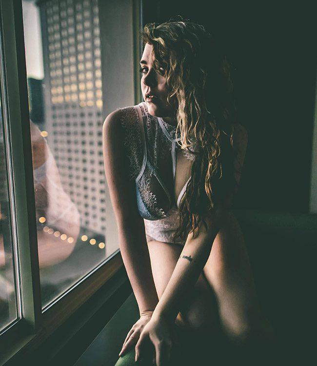 Blithe Velour, posing next to a window