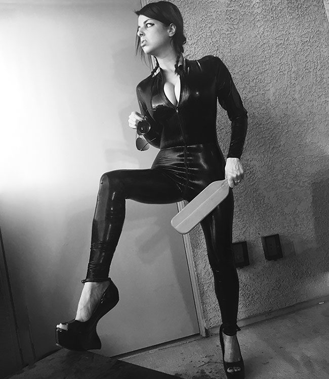 Goddess Vienna, Vegas Dominatrix in latex tights with a paddle