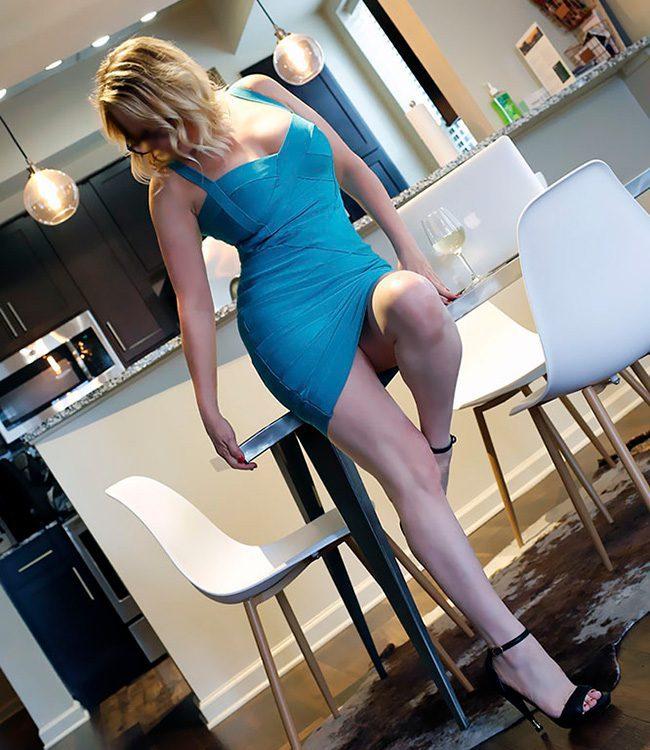 Megan Love, independent escort, wearing short blue skirt