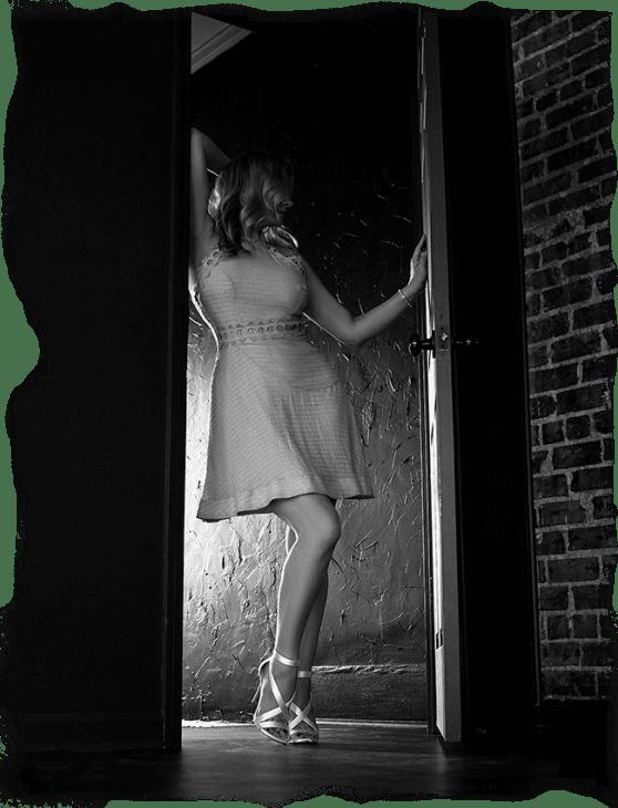 Megan Love, Nashville escort, standing in doorway