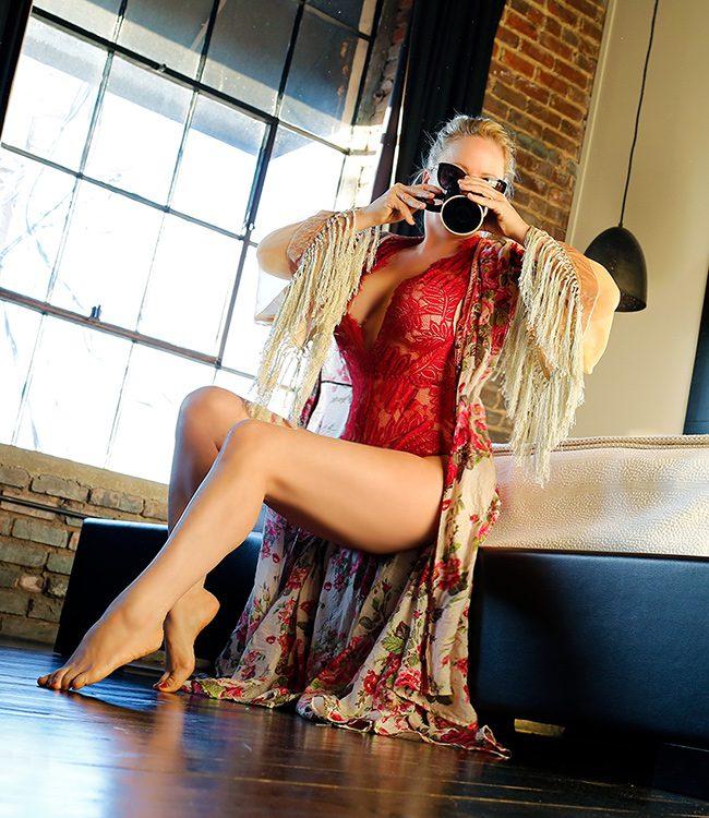 Megan Love, Charlotte escort drinking coffee