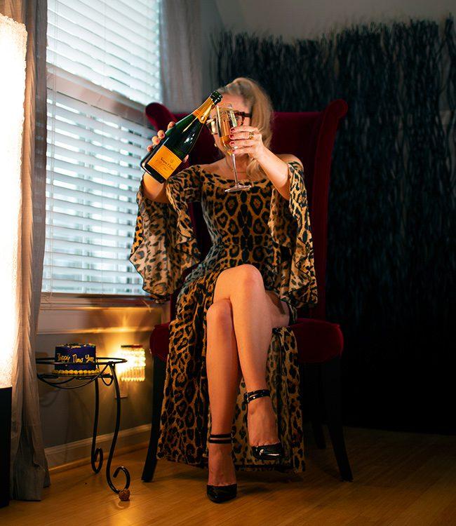 Megan Love, Charlotte escort, pouring champagne
